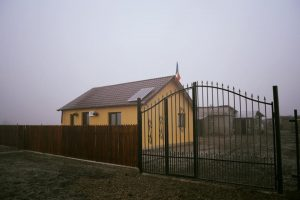 The new house, the fence and the gate next to the old house